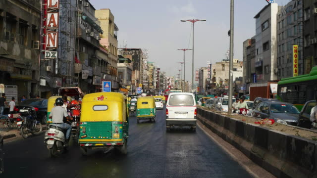 T/L POV of car, Delhi street scenes- busy traffic at Paharganj with it's many hotels