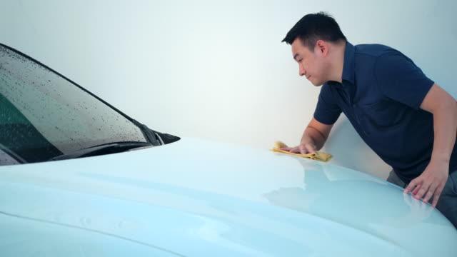 car detailing men - wax stock videos & royalty-free footage