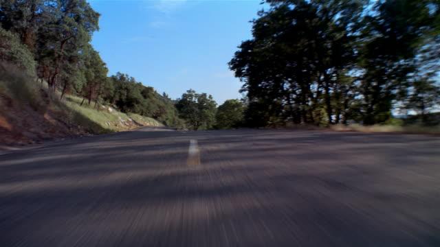 pov, car diving fast on coastal road, california, usa  - coastal road stock videos & royalty-free footage