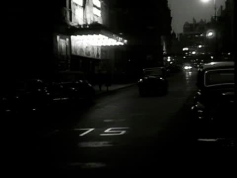 night ws car down london street flashing headlights ws 1st car w/out headlights down street followed by 2nd car flashing lights ws following car ws... - 1949 stock videos and b-roll footage