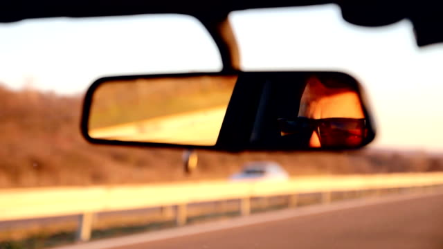 car drive after job - rear view mirror stock videos and b-roll footage