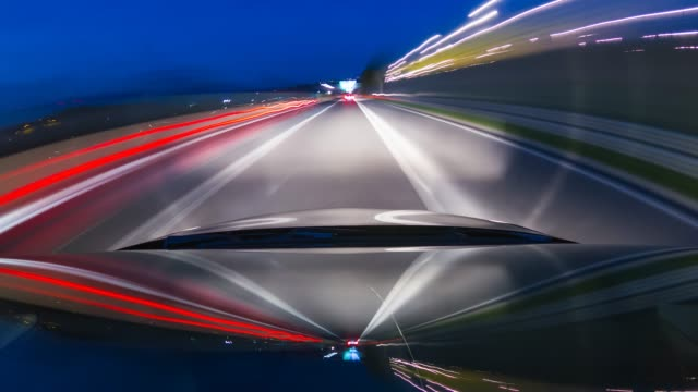 car drive at night on a highway time lapse, view of windshield and vehicle hood - headlight stock videos & royalty-free footage