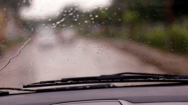 Car drive in rainy season