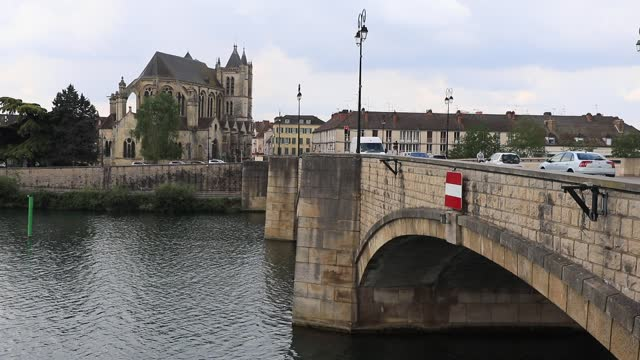 car drive on a bridge across the yonne river, in the background the collegiate church of notre-dame-et-saint-loup near the equestrian statue of... - french revolution stock videos & royalty-free footage