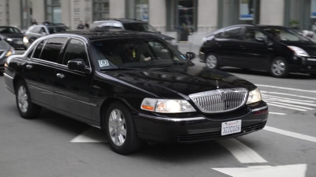 a car driven by a driver working for uber technologies inc drives down a street in san francisco california us on friday feb 21 wide shot of a... - lincoln town car stock videos and b-roll footage