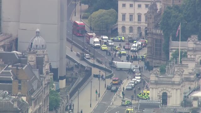 car driven into barriers outside houses of parliament aerials of aftermath england london westminster of emergency services at scene where a car was... - westminster bridge stock-videos und b-roll-filmmaterial