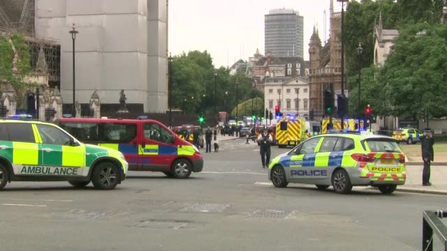 Car driven into barriers outside Houses of Parliament ENGLAND London Westminster EXT Emergency service vehicles and police officers outside Houses of...