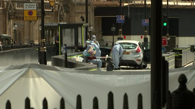 Car driven into barriers outside Houses of Parliament ENGLAND London Westminster EXT Forensic officers examining car crashed into barrier outside...