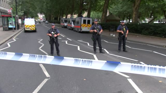 Car driven into barriers outside Houses of Parliament ENGLAND London Westminster Millbank EXT Armed police officers in street with police tape cordon...