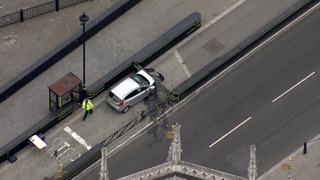 Car driven into barriers outside Houses of Parliament ENGLAND London Westminster Police officer along near car crashed into barrier outside Houses of...