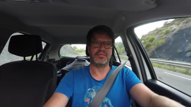 car driver, front view - めがね類点の映像素材/bロール