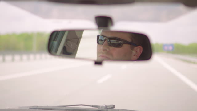 car driver - rear view mirror stock videos and b-roll footage