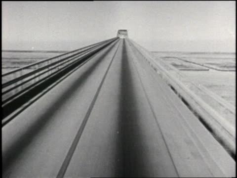 A car drives across a bridge