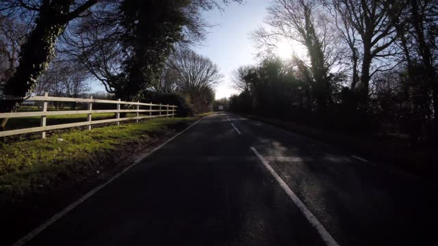 car drives along a county lane near stansted airport on january 22, 2021 in essex, england. - driving stock videos & royalty-free footage