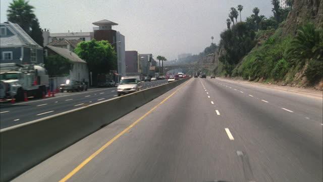 ws pov car drives along coastline malibu pacific coast / california, usa - 2002 stock-videos und b-roll-filmmaterial