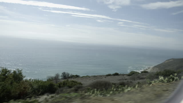 car drives along edge of cliff near coast, shot from moving car - cliff stock videos & royalty-free footage