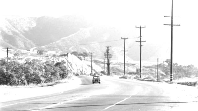 a car drives around a curve on a mountain highway. - 1958 stock videos & royalty-free footage