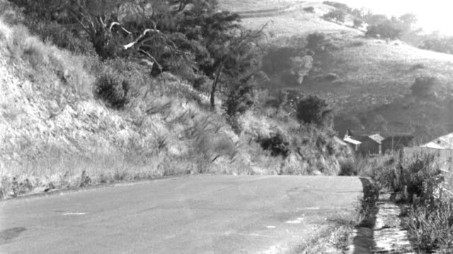 a car drives on a mountain highway. - 1958 stock videos & royalty-free footage