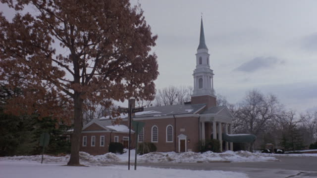 a car drives past a chapel. - arlington virginia stock videos & royalty-free footage