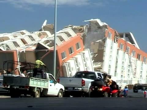 car drives past destroyed houses following devastating earthquake in chile; 4 february 2010 - jordbävning bildbanksvideor och videomaterial från bakom kulisserna