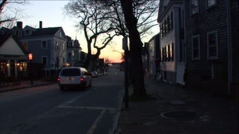 a car drives through a quiet neighborhood in the early morning. - massachusetts stock videos & royalty-free footage