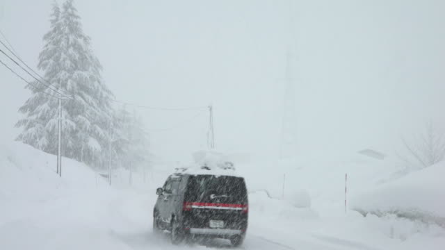 Car drives through blinding snow and ice during major blizzard in northern Japan