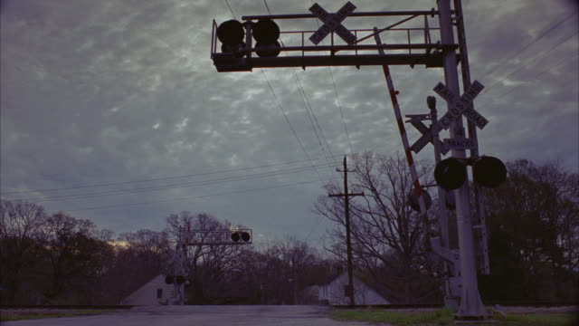WS Car driving across railroad tracks / Newnan, Georgia, United States