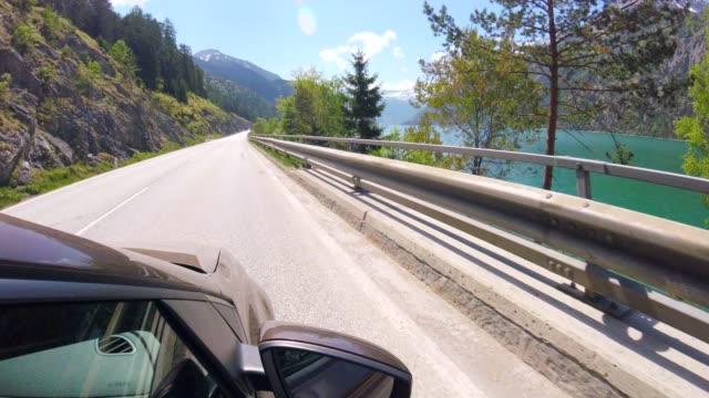 : autofahren pov neben see achensee, österreich - anhöhe stock-videos und b-roll-filmmaterial