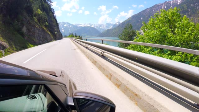 car pov: driving alongside lake achensee, austria - tyrol state austria stock videos and b-roll footage