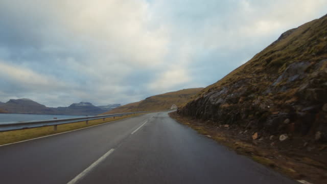 pov car driving at faroe islands: winter roads - wet stock videos & royalty-free footage