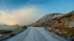 POV car driving at Faroe Islands: winter roads