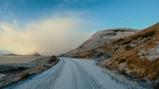 vídeos de stock e filmes b-roll de pov car driving at faroe islands: winter roads - ponto de vista