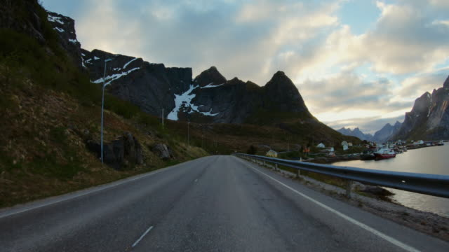 pov car driving at lofoten islands: summer roads - straight stock videos & royalty-free footage