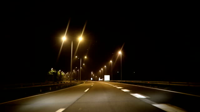 Car driving at night on highway, POV