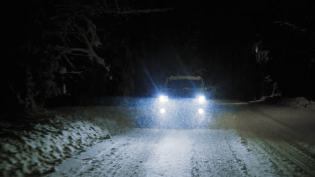 ts car driving at night on snowy road in snowfall - headlight stock videos & royalty-free footage