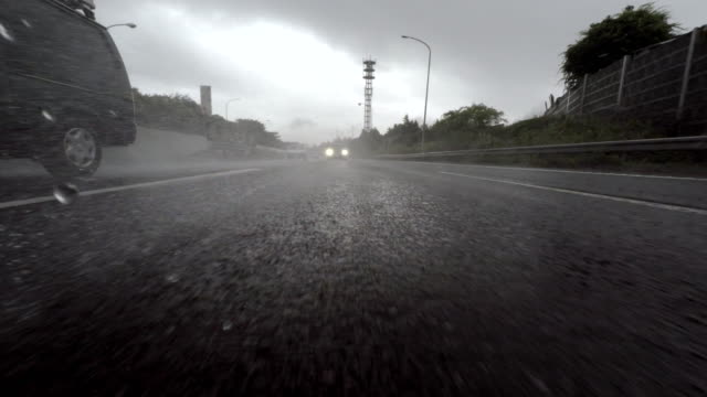 Car driving at rainy day - 4K - rear view
