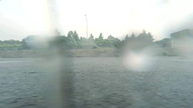 Car driving at rainy day - side view