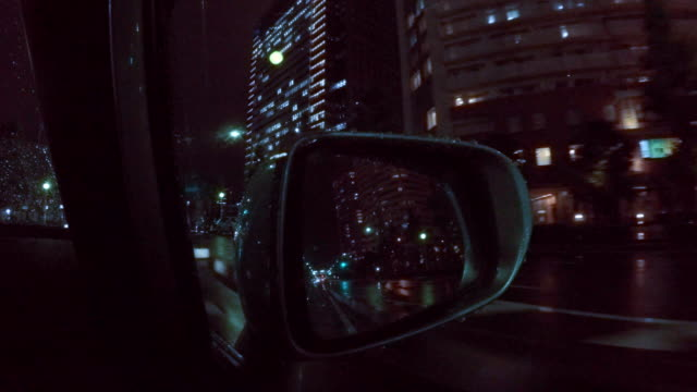 car driving at rainy night city  -4k- - stop sign stock videos & royalty-free footage