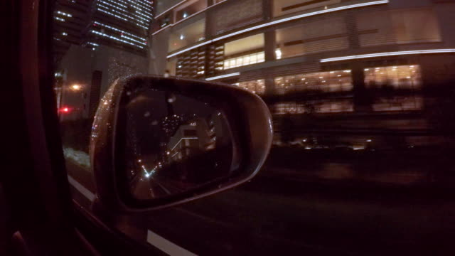 car driving at rainy night city  -4k- - bodywork stock videos & royalty-free footage