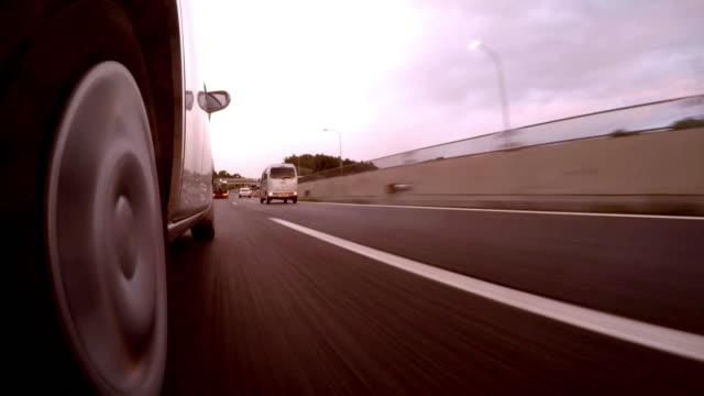 Car driving at rainy sunset  -4K-