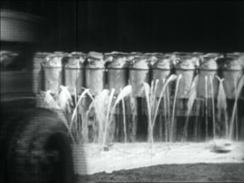b/w 1934 car driving away as beer spills from shot up kegs - 1934 stock videos & royalty-free footage