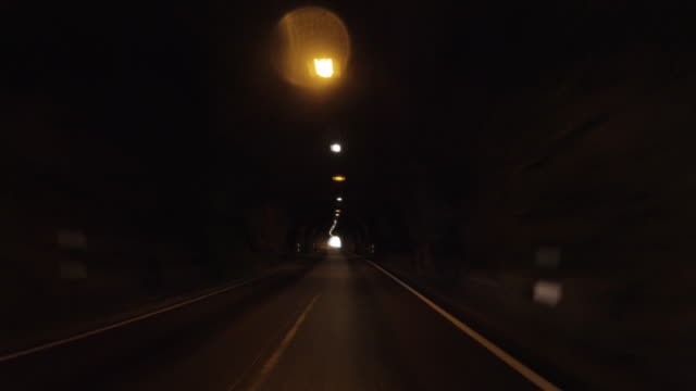 pov car driving by in norway: out of the tunnel, into the white light - narrow stock videos & royalty-free footage