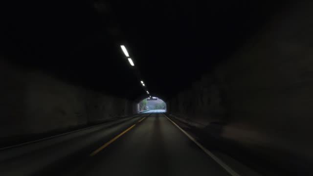 vídeos y material grabado en eventos de stock de coche pov conduciendo por noruega: fuera del túnel - perspectiva de un coche