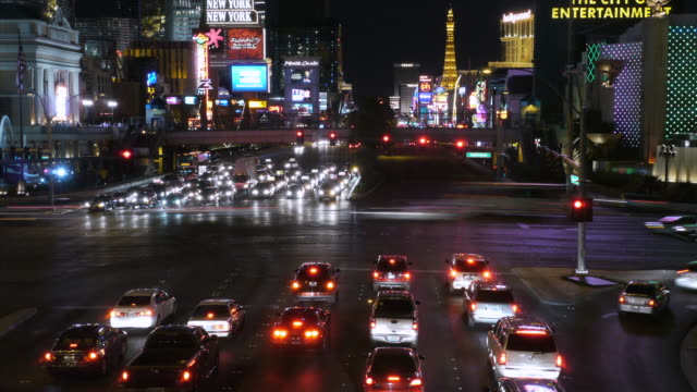 ws t/l car driving by lights traffic at night / las vegas, nevada, usa - tail light stock videos & royalty-free footage