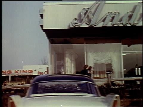 vidéos et rushes de 1957 montage car driving by parking lot, shopping centers / brussels, belgium - 1957