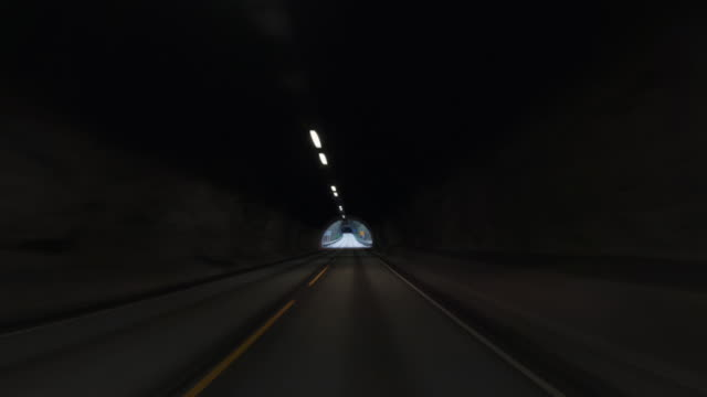 pov car driving by the fjords of norway: inside the tunnel - curve stock videos & royalty-free footage
