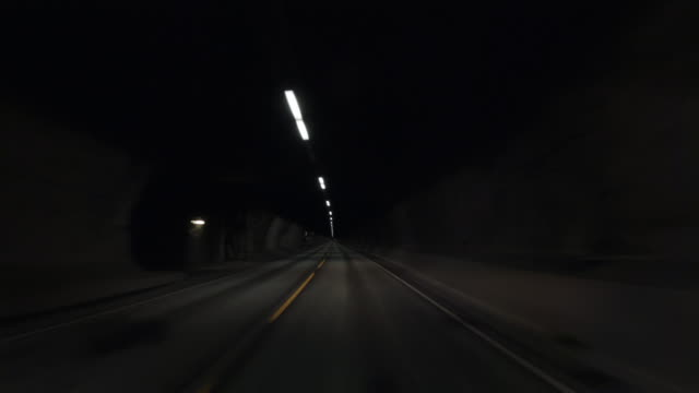 pov car driving by the fjords of norway: inside the tunnel - narrow stock videos & royalty-free footage