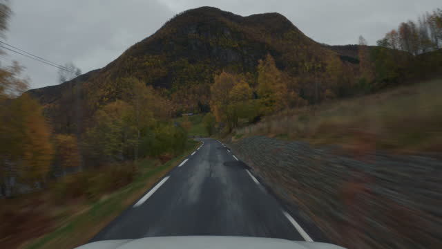 pov car driving by the fjords of norway: outdoor in autumn - country road stock videos & royalty-free footage