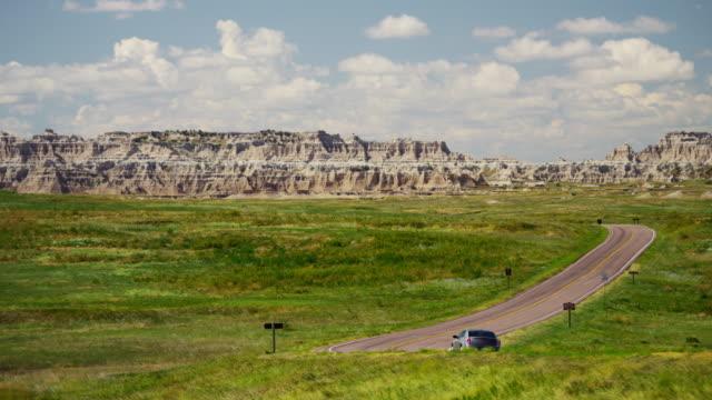 car driving dakota badlands desert buttes outdoor usa - south dakota stock-videos und b-roll-filmmaterial