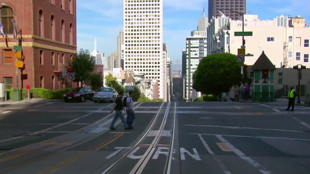 WS car POV driving down steep and busy street/ San Fransciso, California